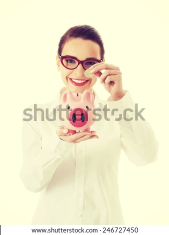 Beautiful business woman with coin and piggy- bank.  - stock photo