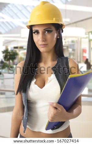 Beautiful business woman with folders