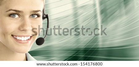 Beautiful  business woman with headset. Call center. Customer support. Helpdesk. . - stock photo