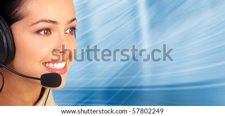 Beautiful  business woman with headset. Over blue  background