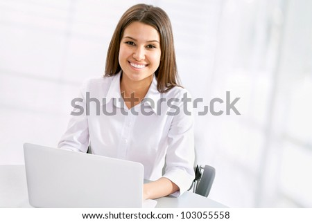 Beautiful business woman working at lapnop - stock photo