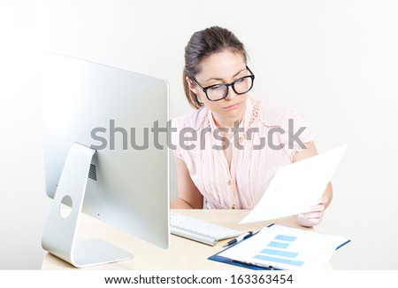 Beautiful business woman working on computer at her office
