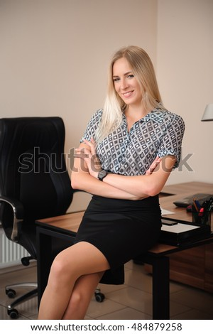 Beautiful business woman working with sales in her office