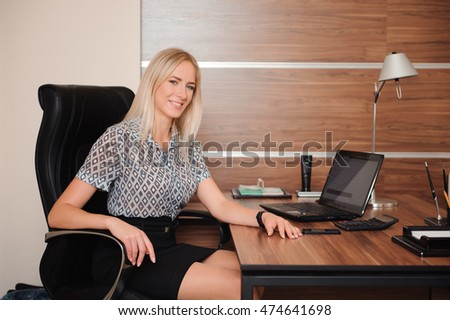 Beautiful business woman working with sales in his office