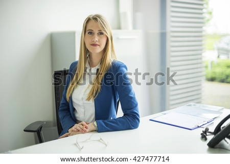 Beautiful business women meet business partners. Business decisions. Office workers. Friendly smiling girl. Beautiful light background. - stock photo