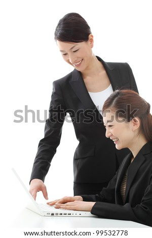 Beautiful business women working in team together on laptop computer. Portrait of asian woman. - stock photo