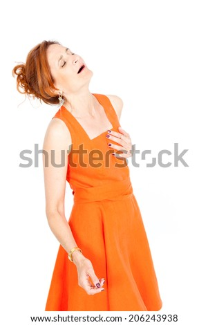 Beautiful businesswoman doing different expressions in different sets of clothes: heart attack - stock photo