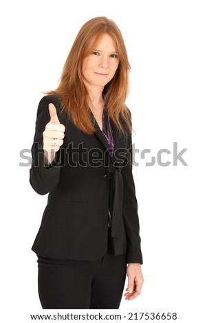 Beautiful businesswoman doing different expressions in different sets of clothes: thumbs up - stock photo