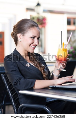 Beautiful businesswoman having fun in cafe - stock photo