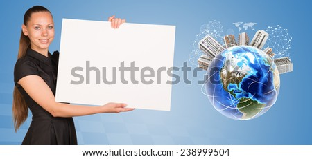 Beautiful businesswoman holding blank paper sheet. Beside is miniature Earth with houses on it and surrounded by conventional communication lines and other virtual elements. Elements of this image - stock photo