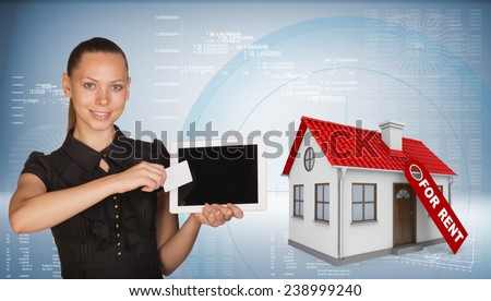 Beautiful businesswoman holding blank tablet PC and blank business card in front of PC screen. Beside is model house with tag for rent. Hi-tech graphs with various data as backdrop - stock photo