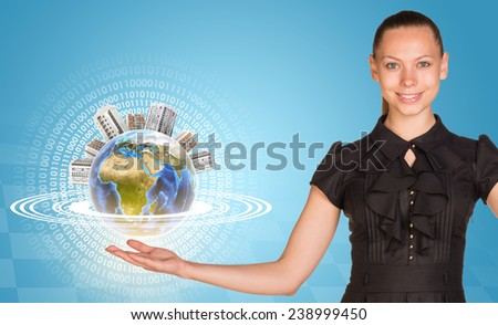 Beautiful businesswoman holding miniature Earth with houses on it and surrounded by rings, part of them composed of digits. Elements of this image furnished by NASA - stock photo