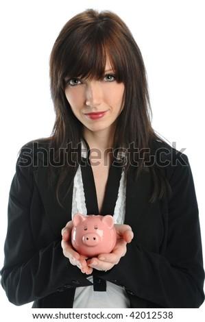 Beautiful businesswoman holding piggy bank - stock photo