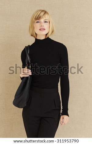 Beautiful businesswoman in fashionable clothes, portrait - stock photo