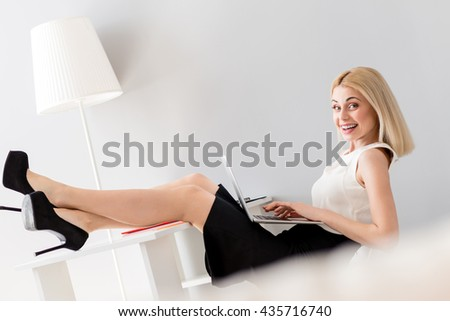 Beautiful businesswoman is relaxing during work - stock photo