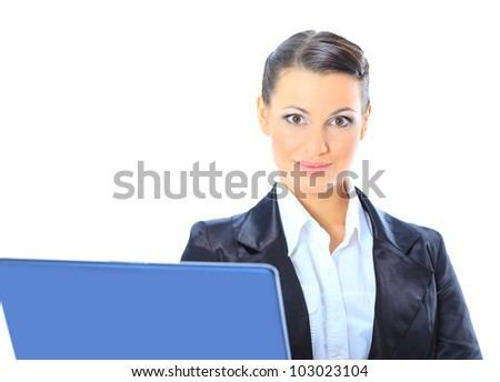 Beautiful businesswoman keeps the laptop.