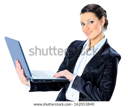 Beautiful businesswoman keeps the laptop. - stock photo