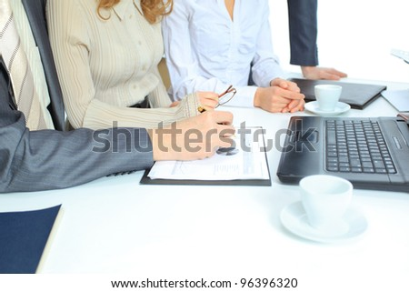 Beautiful businesswoman keeps the laptop. Isolated on a white background.