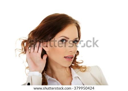 Beautiful businesswoman overhears. - stock photo