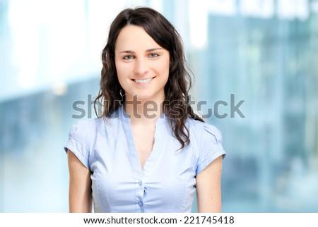 Beautiful businesswoman portrait in a modern office  - stock photo