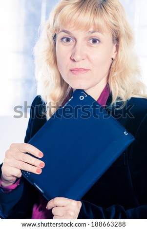 Beautiful businesswoman portrait with tablet in office - stock photo