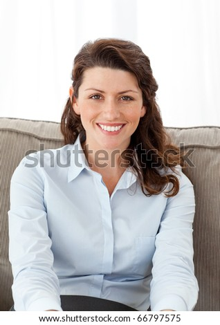 Beautiful businesswoman relaxing on the sofa at home - stock photo