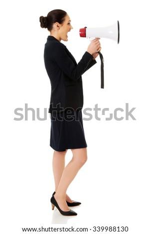 Beautiful businesswoman screaming through megaphone. - stock photo