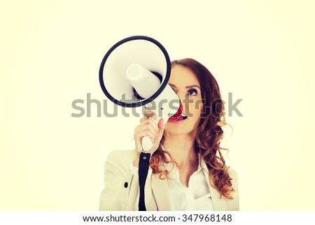 Beautiful businesswoman shouting with megaphone. - stock photo