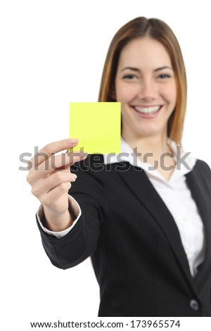 Beautiful businesswoman showing a blank yellow paper note isolated on a white background - stock photo