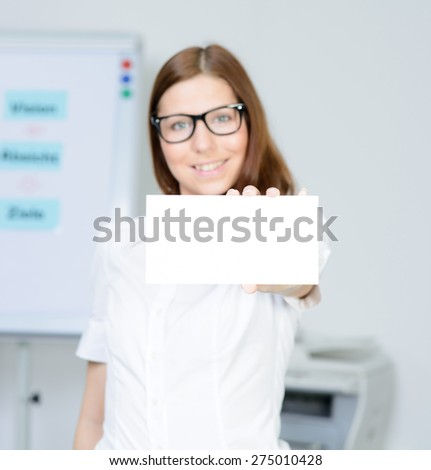 beautiful businesswoman shows a blank business card - stock photo