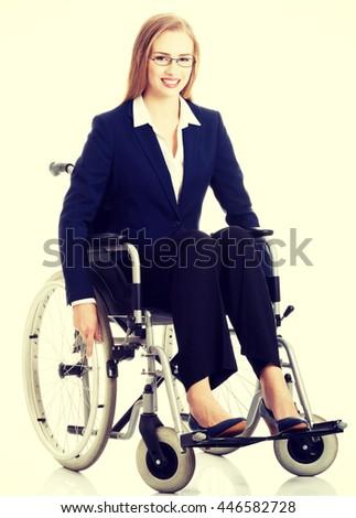 Beautiful businesswoman sitting on wheelchair. - stock photo
