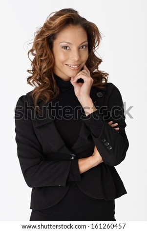 Beautiful businesswoman smiling arms crossed over white background.