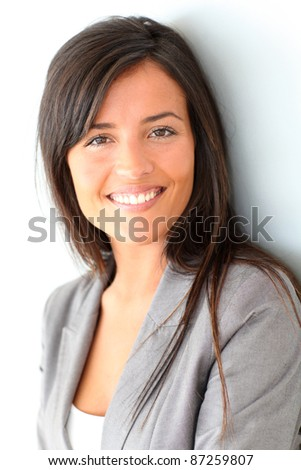 Beautiful businesswoman standing on grey background