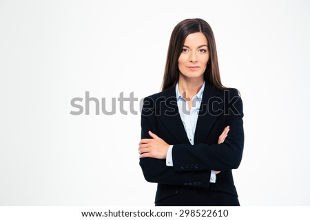 Beautiful businesswoman standing with arms folded isolated on a white background. Looking at camera - stock photo