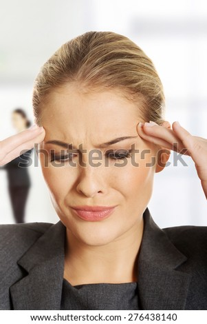 Beautiful businesswoman suffering from headache. - stock photo