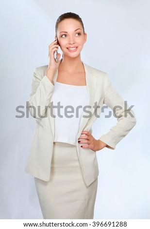 Beautiful businesswoman using cell phone  - stock photo