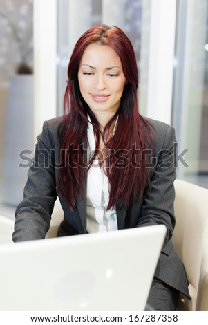 Beautiful businesswoman using laptop