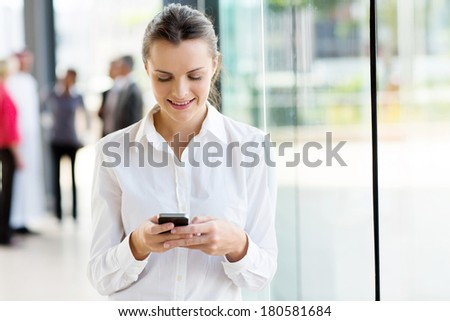 beautiful businesswoman using mobile phone  - stock photo