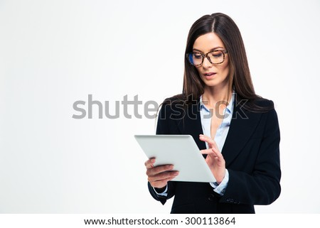 Beautiful businesswoman using tablet computer isolated on a white background - stock photo