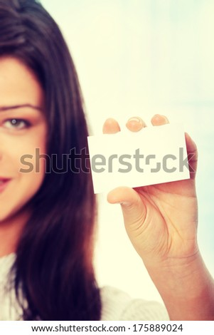 Beautiful businesswoman with business card - stock photo