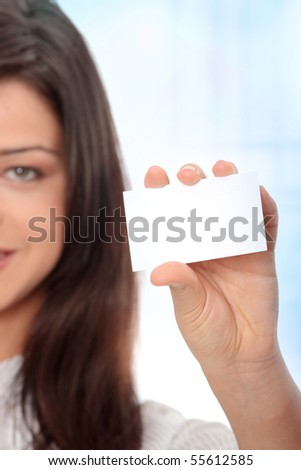 Beautiful businesswoman with business card, Over abstract blue background - stock photo