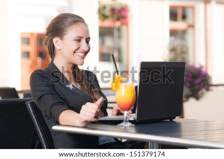 Beautiful businesswoman working in cafe   - stock photo