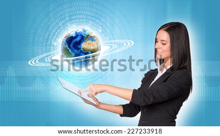 Beautiful businesswomen in suit using digital tablet. Earth with figures and graphs. Element of this image furnished by NASA - stock photo
