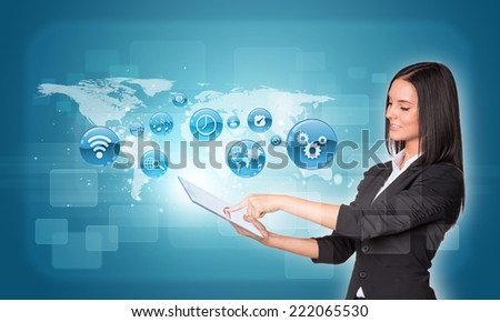 Beautiful businesswomen in suit using digital tablet. World map with app icons - stock photo