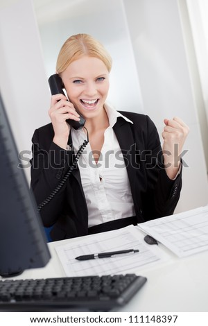 Beautiful businesswomen talking on the phone in the office