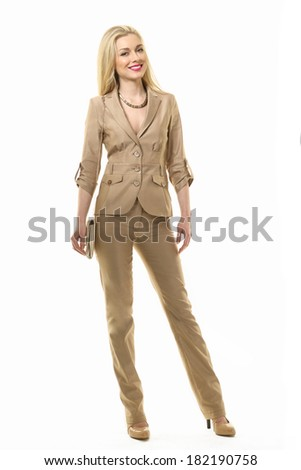 Beautiful Busyness Woman Blonde Fashion Model in beige summer trousers suit  isolated on white