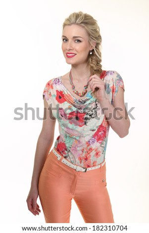 Beautiful Busyness Woman Blonde Fashion Model in floral blouse and summer trousers isolated on white