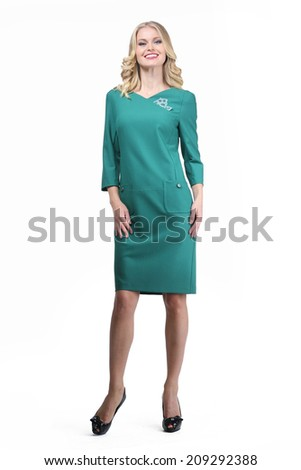 Beautiful Busyness Woman Blonde Fashion Model in long sleeve green dress