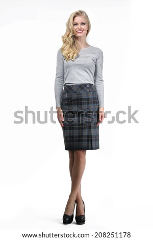 Beautiful Busyness Woman Blonde Fashion Model in office skirt and blouse