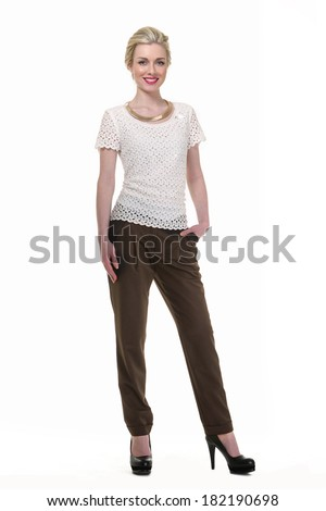 Beautiful Busyness Woman Blonde Fashion Model in white blouse and black trousers isolated on white